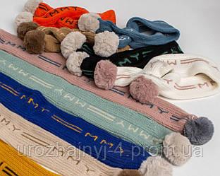 Детский вязанный шарфик с бумбонами