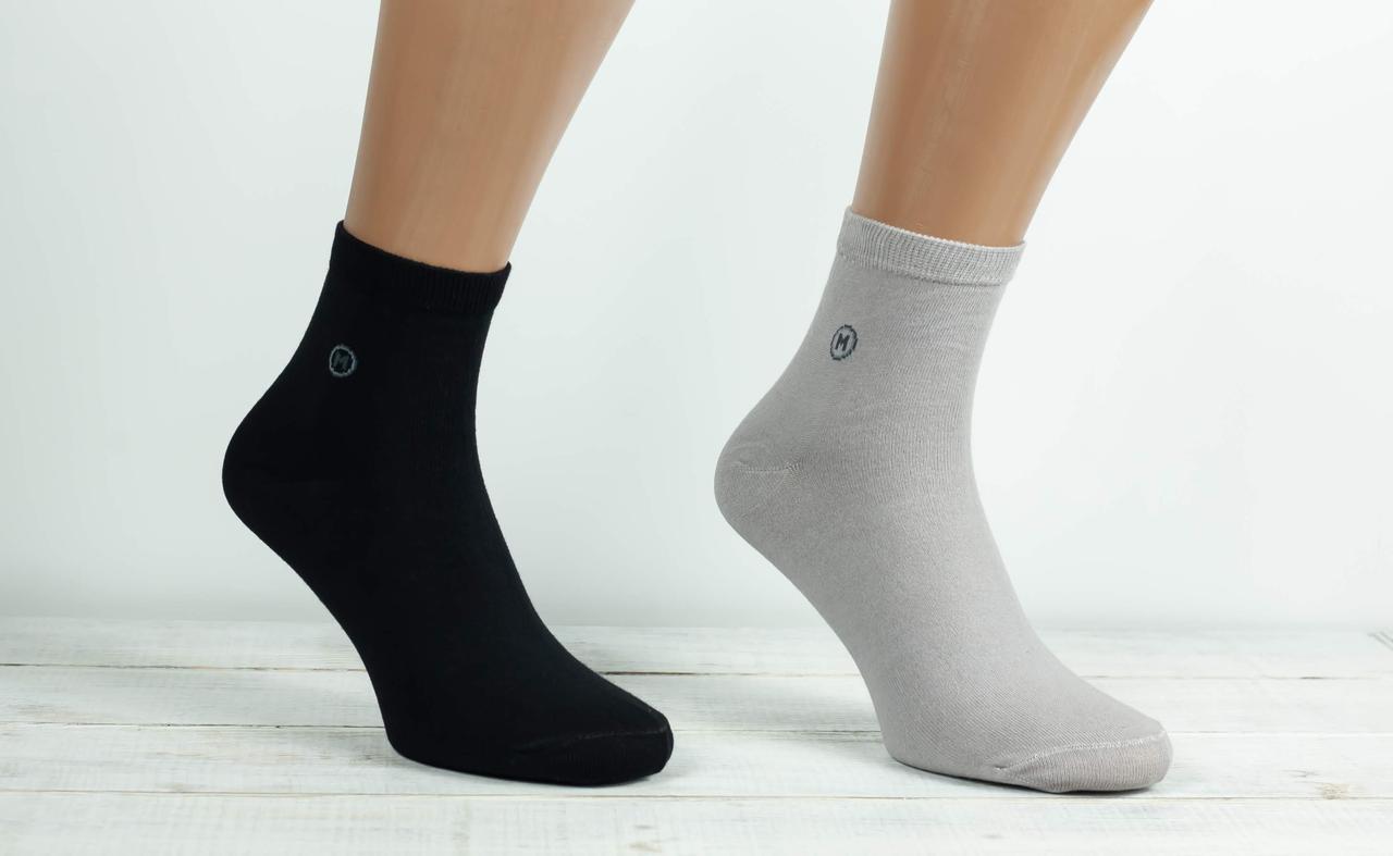 Чоловічі однотонні носки шкарпетки Montebello з бавовни з буквою М 40-45 12 шт в уп мікс 4х кольорів
