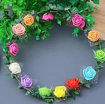 Веночек на голову из разноцветных цветов с листочками.