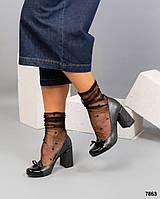 Элегантные туфли с тиснением под рептилию