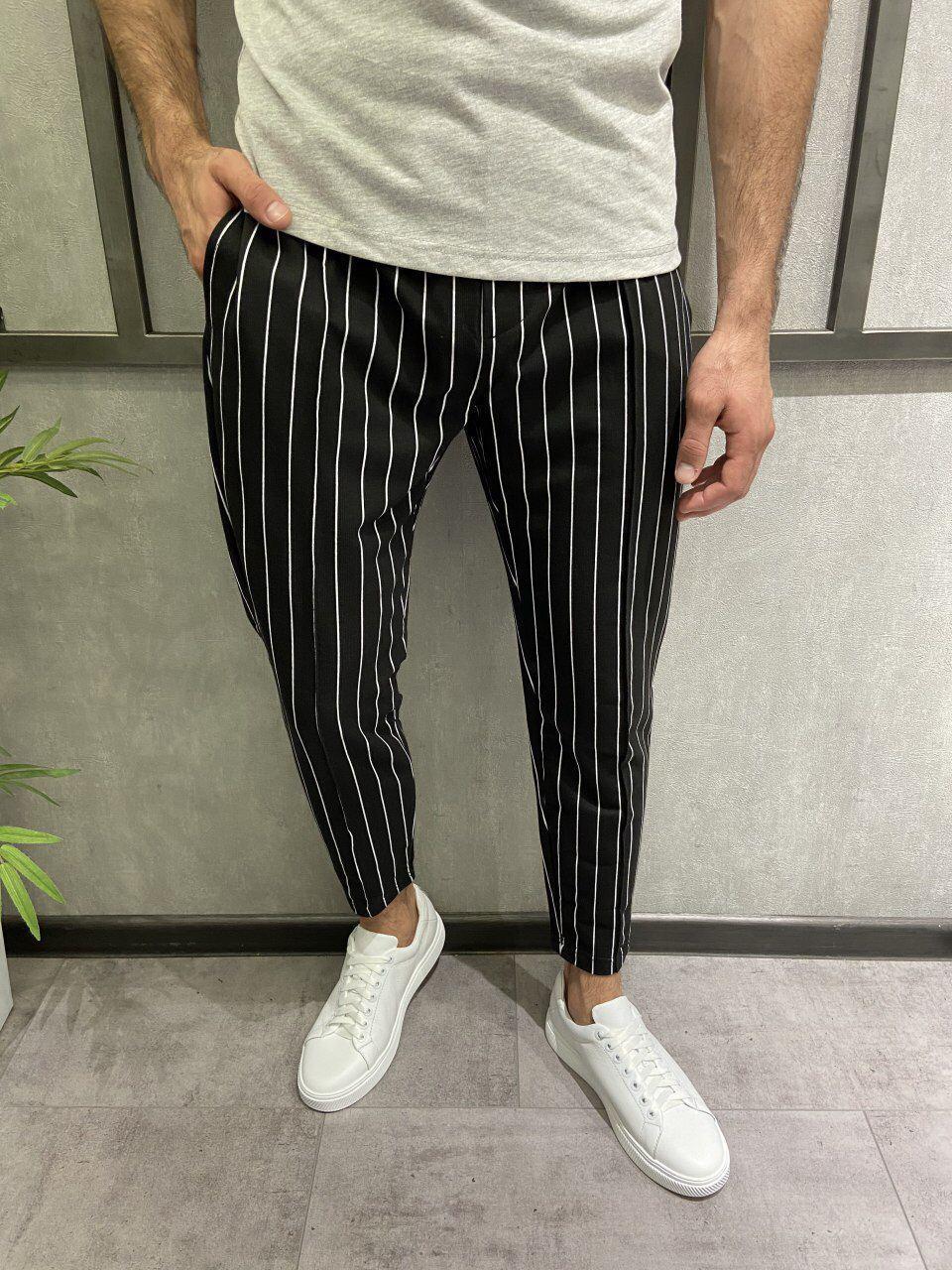Чоловічі штани чорні в білу смужку