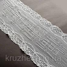 Стрейчевое (еластичне) мереживо білого кольору шириною 21.5 див.