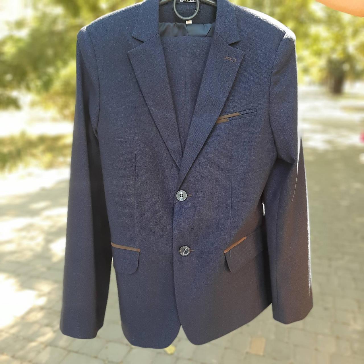 Школьный костюм двойка для мальчика синего цвета BOZER р. 152