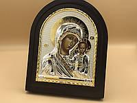 Икона в чёрной деревянной рамке