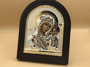 Икона в черной деревянной рамке