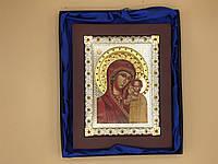 Икона в квадратной деревянной рамке
