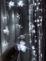 Новорічна світлодіодна гірлянда штора на вікні «200 білих орхідей»