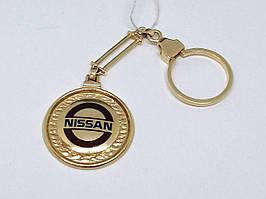 Золотой брелок NISSAN. Артикул 5221550 NISSAN