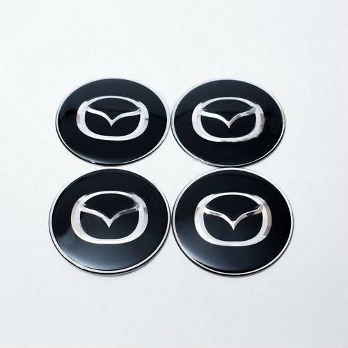 Наклейки для ковпачків Mazda чорні/хром лого (65 мм)
