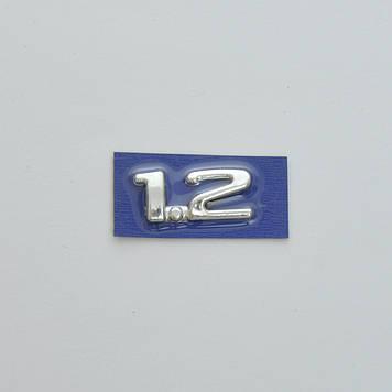 "Эмблема - надпись   ""1.2"" (Corsa 1-2)  скотч 40x18 мм 1996-2004 (5680)"