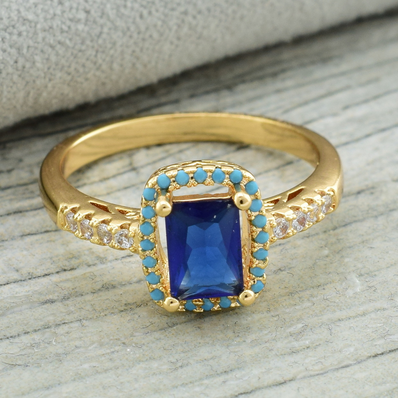 Кольцо Xuping 11881 размер 16 ширина 10 мм синие фианиты вес 2.7 г позолота 18К