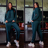 Р-48-50, 52-54, 56-58 Женский, модный трикотажный спортивный костюм.Кофта с капюшоном+брюки с лампасом.Зеленый