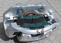 LANOS ЛАНОС Суппорт пер. левый с колодками Ланос 1,6, Нексия 16 клап. GM Корея (ориг) 96212321