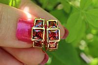 Серьги кольца с красными камнями