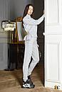 Женский вязаный костюм - двойка с асимметричной кофтой и штанами (р. S-M) 31ks1384, фото 3