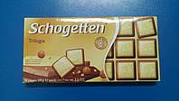 Шоколад TRUMPF Schogetten трилогия молочный белый с орехом 100г