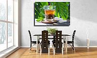 """Картина для кухни на холсте """"Черный чай в стеклянной чашке на деревянном столе и фоне листьев"""""""