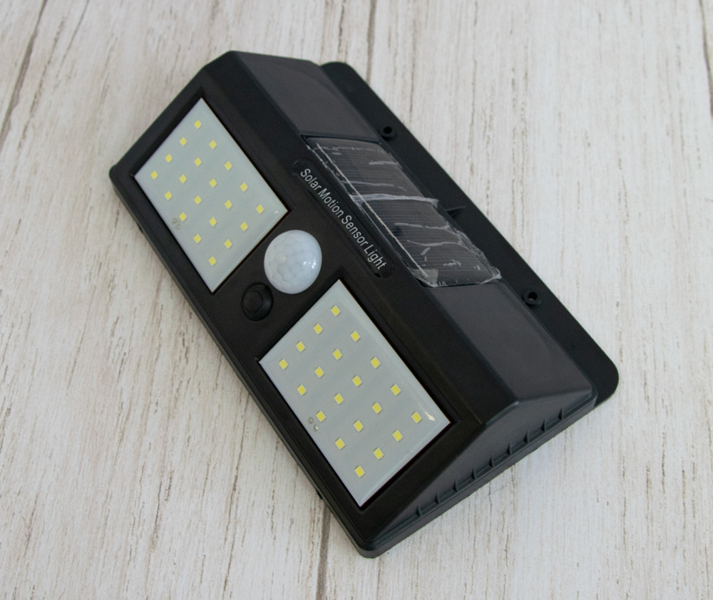 Распродажа! Уличный led светильник-фонарь на солнечной батарее с датчиком движения YH818 - вуличний ліхтар