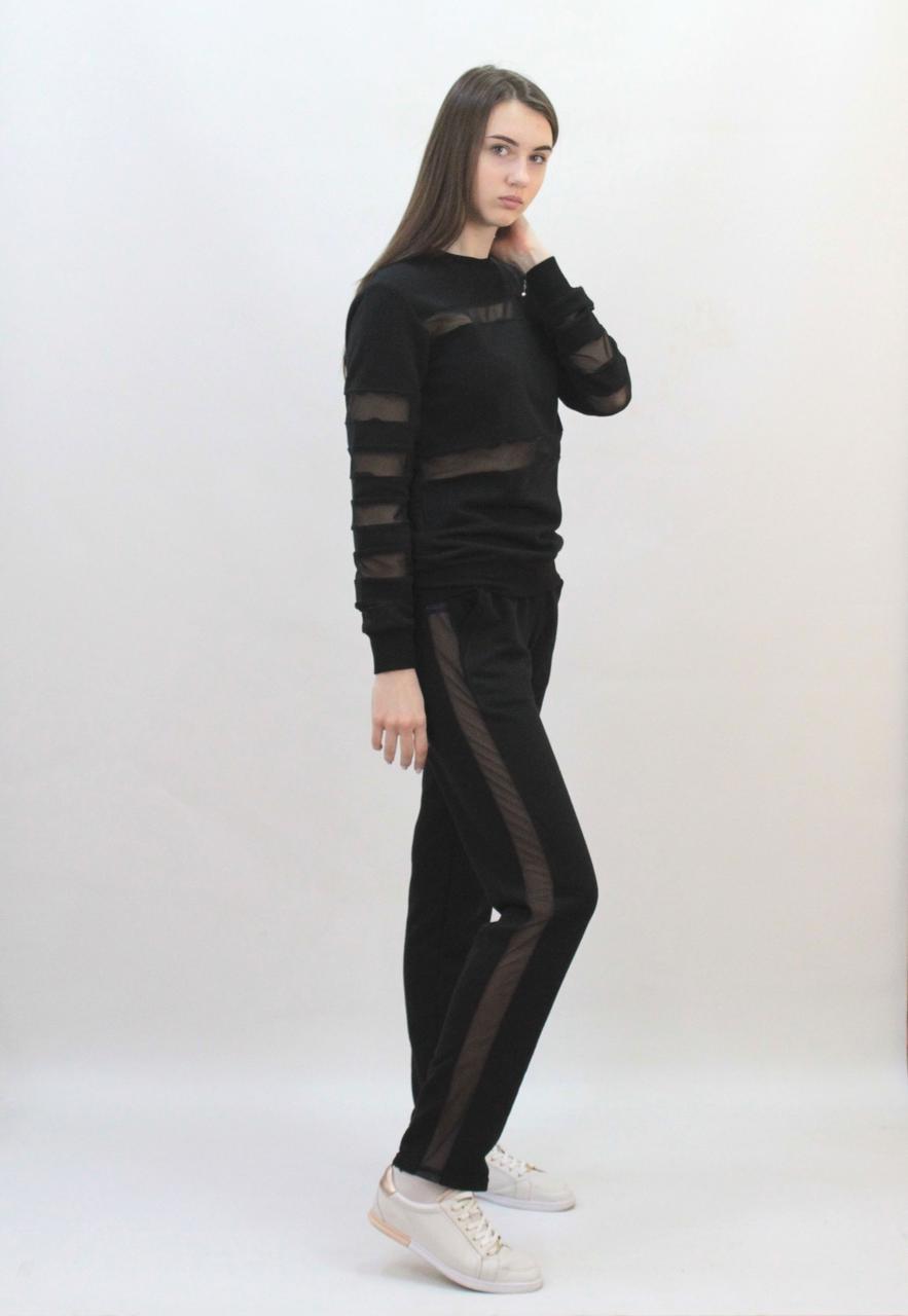Костюм женский черный с горизонтальными вставками и лампасами из черной сетки