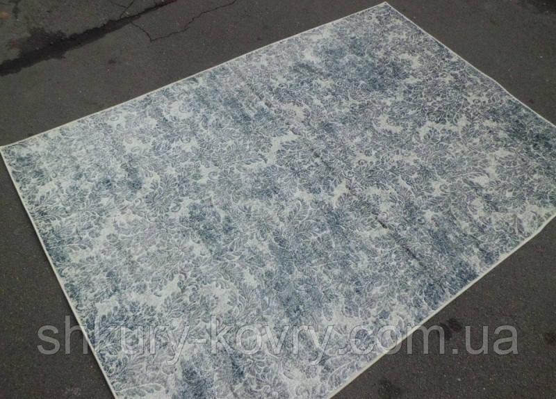 Потертые ковры в голубых тонах бельгийские