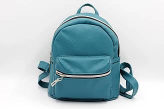 Женский компактный рюкзак из кож-зама бирюзового цвета.