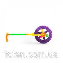 Каталка-колесо Трещалка  издает звуки детская на палке 3620 Т