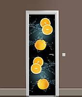 Декоративна 3Д наклейка на двері Апельсини на чорному фоні (вінілова плівка ПВХ) цитрусові Фрукти 650*2000 мм