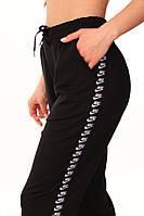 Штаны чёрные с лампасами Nike