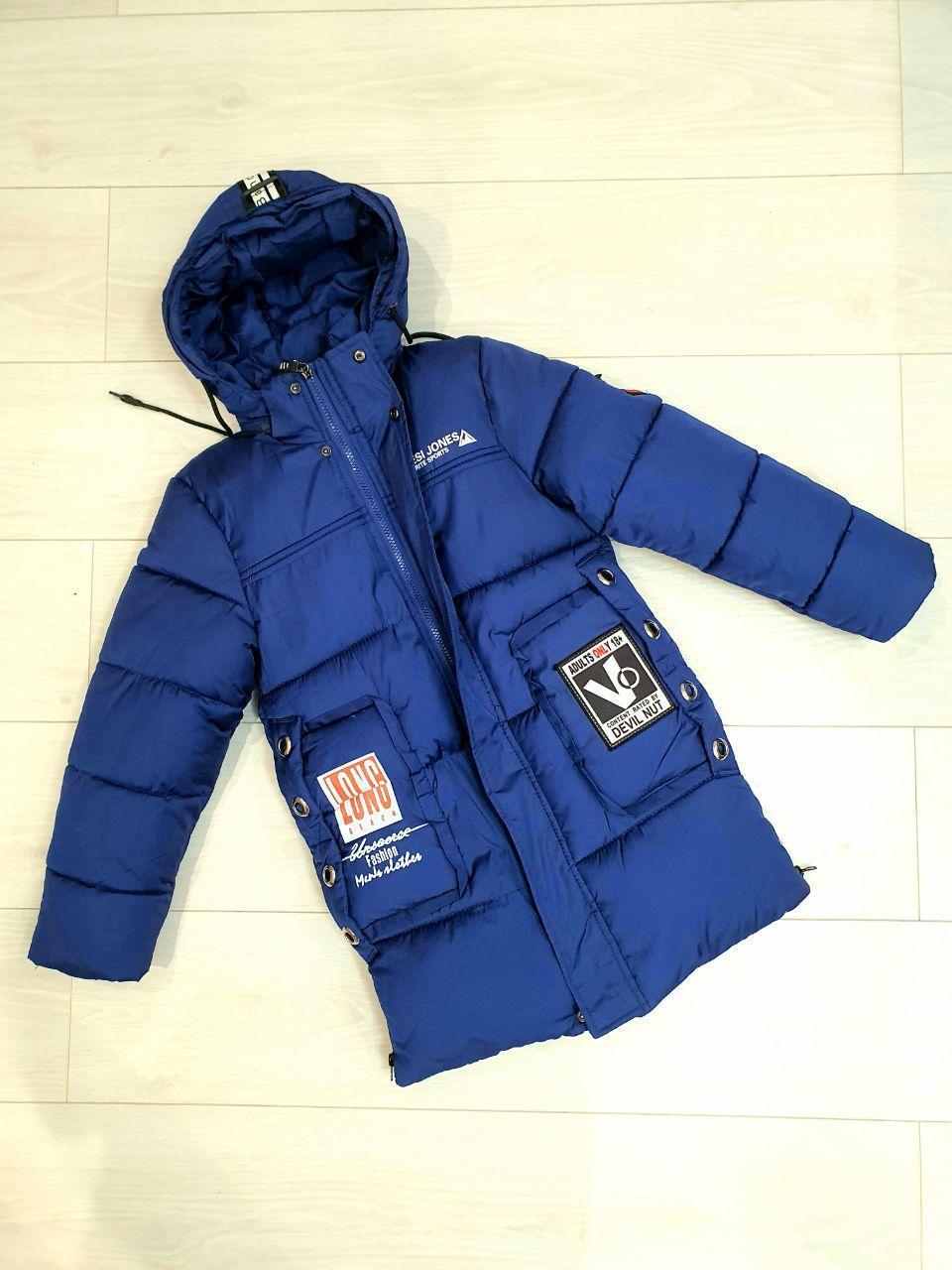 Удленненая синя куртка зимова на ріст 134