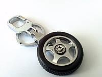 Брелок  в форме колеса с логотипом Skoda