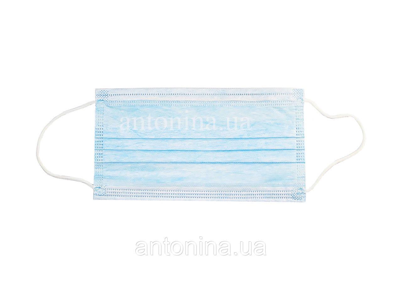 Маска захисна на резинці блакитна