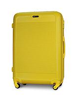 Чемодан Fly 1093 большой 74х51х30см 90 л пластиковый на 4 колесах Желтый