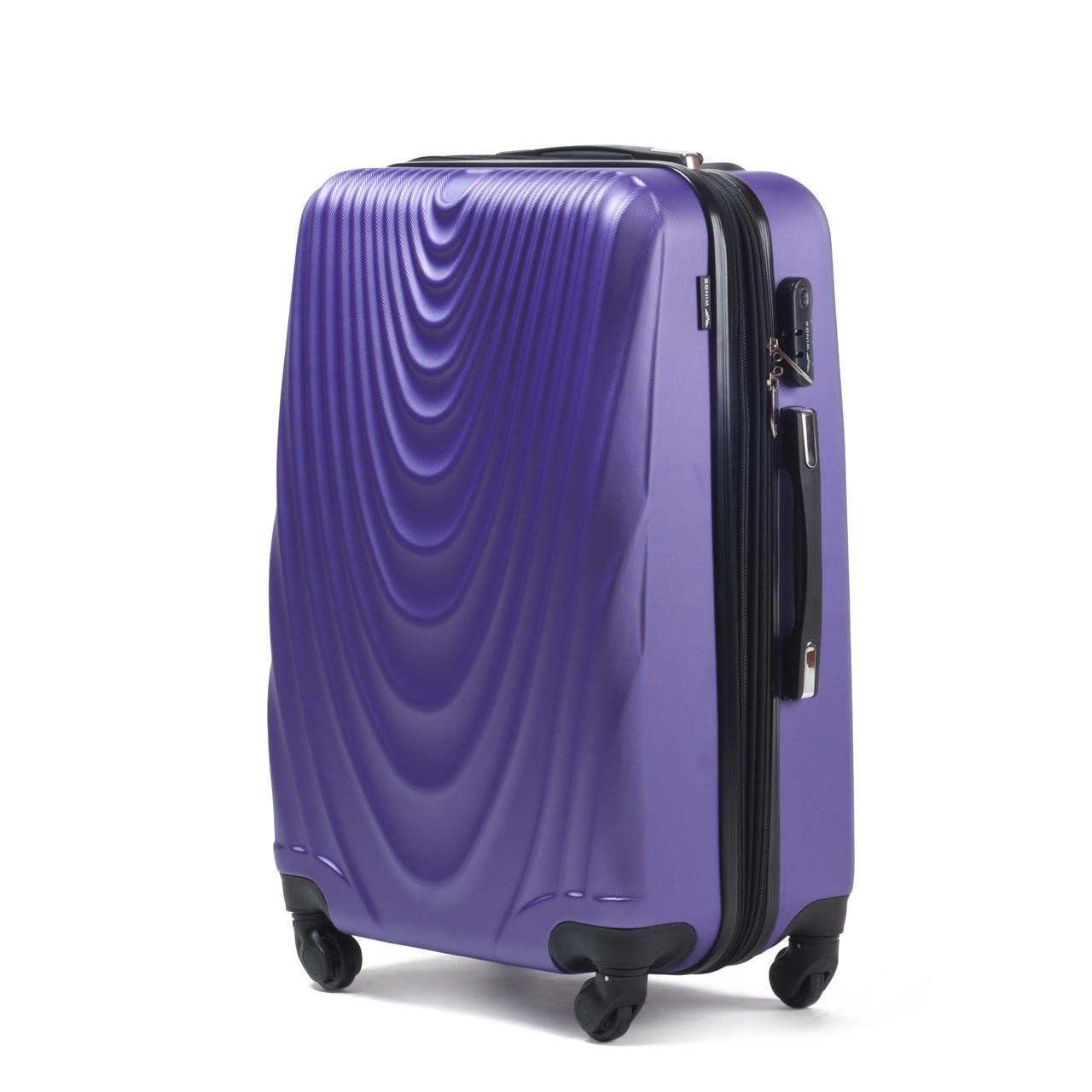 Чемодан Wings 304 средний 66х43х27 см 66л пластиковый на 4 колесах Фиолетовый