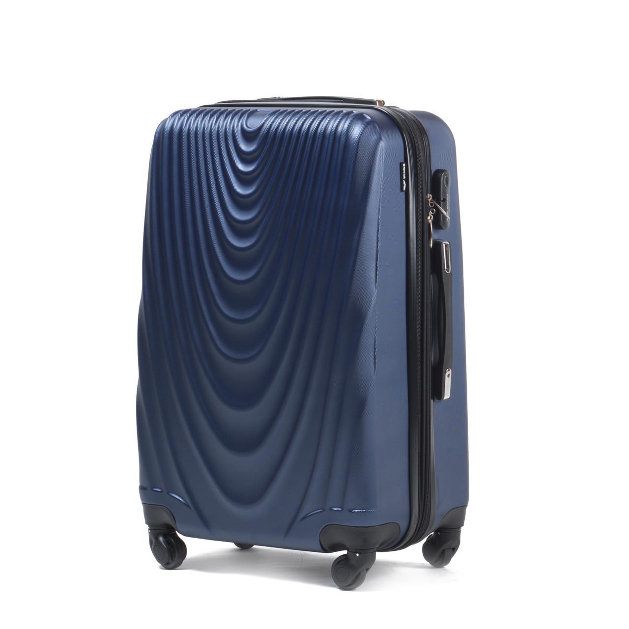 Чемодан Wings 304 средний 66х43х27 см 66л пластиковый на 4 колесах Темно-синий
