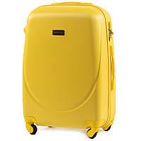 Чемодан Wings K310 средний 65х44х27 см 62 л пластиковый на 4 колесах Желтый