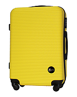 Чемодан Fly 91240 средний 65х42х24 см 60 л пластиковый на 4 колесах Желтый