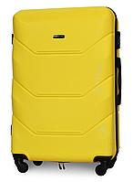 Чемодан Fly 147 большой 78х49х28 см 90л пластиковый на 4 колесах Желтый