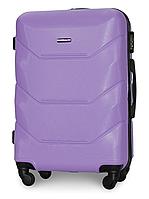 Чемодан Fly 147 средний 67х43х26 см 60л пластиковый на 4 колесах Светло-фиолетовый