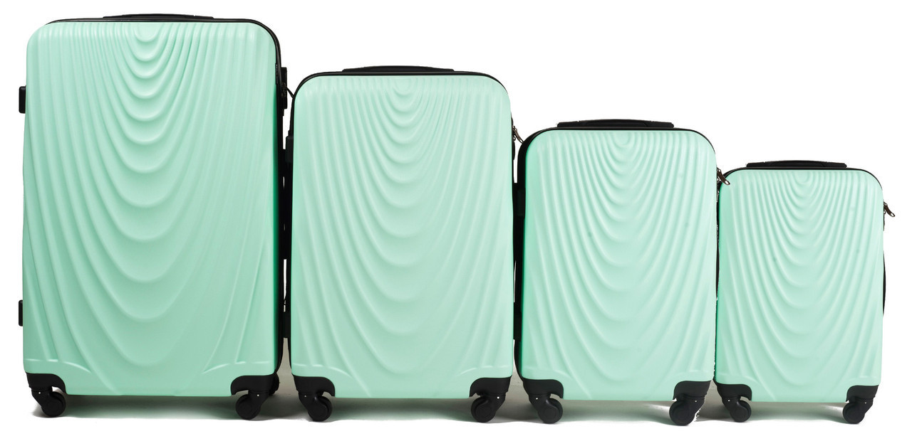 Набор чемоданов 4 штуки в 1 Wings 304 на 4 колесах Мятный