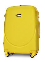 Чемодан Fly К310 большой 75х47х29 см 90л пластиковый на 4 колесах Желтый