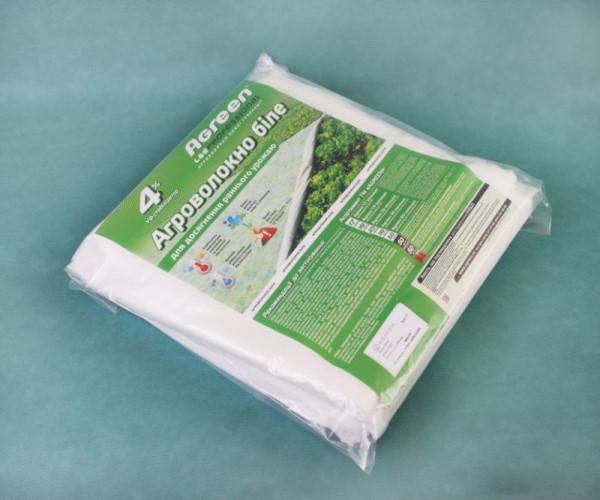 Біле агроволокно фасоване в пакетах, пакетоване