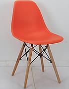 Стілець обідній пластиковий на букових ніжках Nik, помаранчевий 70