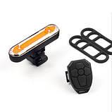 """Ліхтар велосипедний """"STOP"""" із зазначенням поворотів (червоний+жовтий), ЗУ micro USB, вбуд. акум., пульт керування, фото 7"""