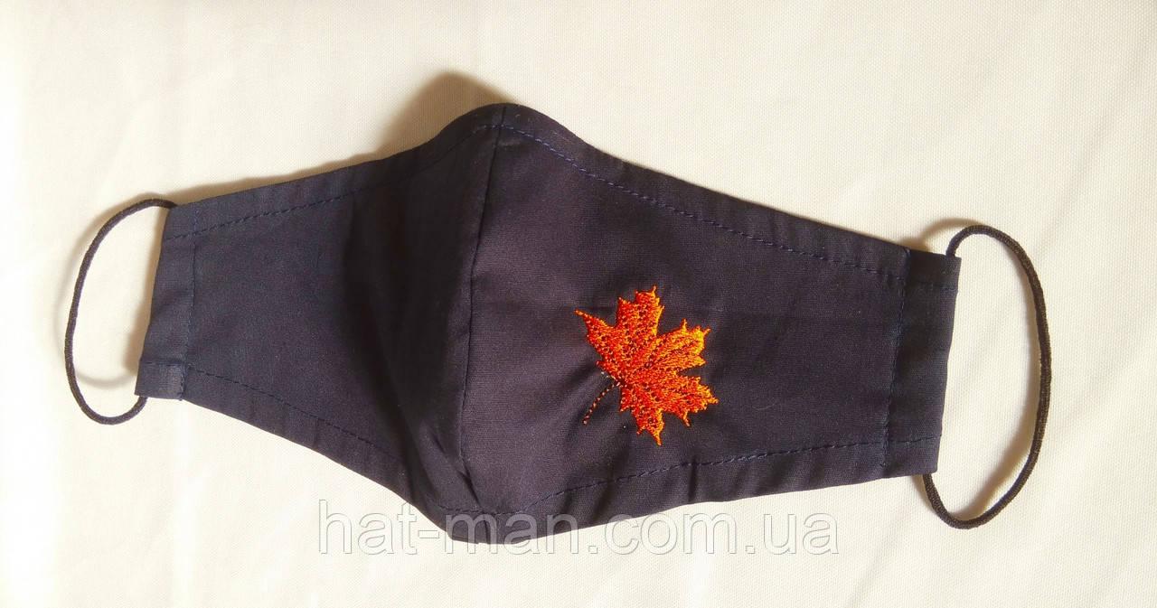 З листочком на темно-синій тканині