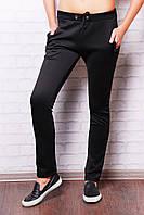 Черные узкие женские брюки спортивного фасона с завязкой на талии и косыми карманами