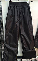 Детские штаны плащевка на флисе оптом 116-140 черные