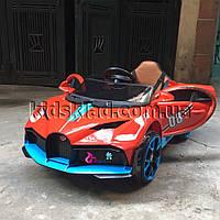Детская машина на аккумуляторе Bugatti (2 мотора по 18W, MP3, функция качания) Baby Tilly T-7657 EVA RED