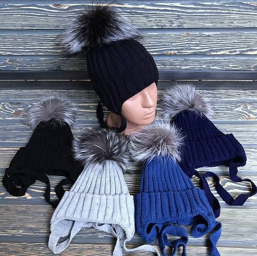 Детская вязанна шапка на флисе на завязками с натуральным бубоном чернобурки
