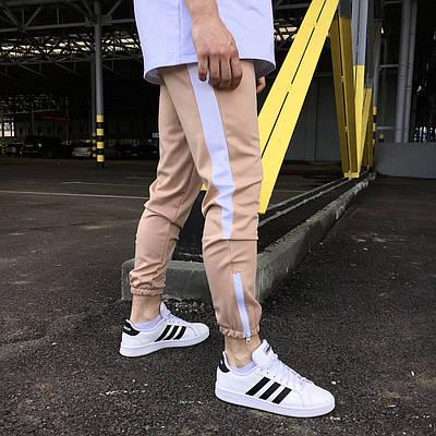 Беженвые спортивные зауженые штаны на манжете брендовые с белой полоской
