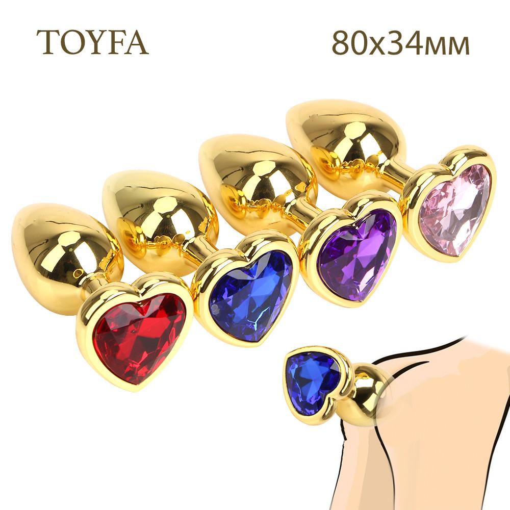 Анальная пробка средняя золотая с камнем сердечком  в форме сердца TOYFA Metal M